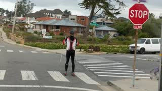 Guy skiing on streets with rollerblades red white black jacket