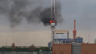 Watch This Burning Crane Collapse! - Video