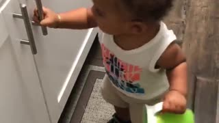 Frustrated Toddler Tries to Open Cabinet