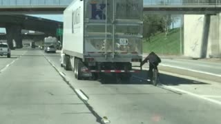 Cyclist Hitches Ride on Semi Truck on Highway
