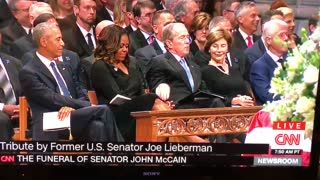 George W. Bush Slips Candy To Michelle Obama - Video
