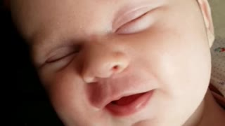 Baby preciously giggles in her sleep - Video