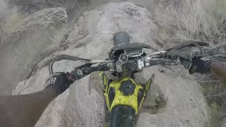 Riding through a flash flood on a dirt bike - Video