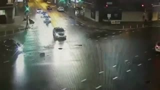 Drunk driver runs red light, hits police car