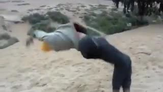 Guy yellow beanie backflip fail sand - Video
