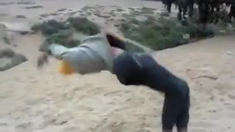 Guy yellow beanie backflip fail sand