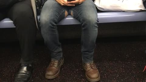 Man with tears on the inside of his jeans