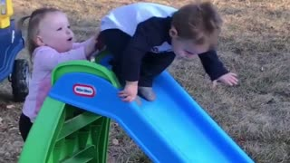 Collab copyright protection - girl pushes boy down blue slide