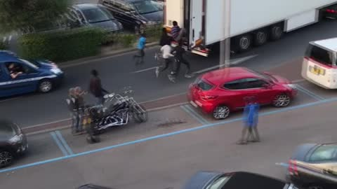 Refugees Run After and Chase Down Truck