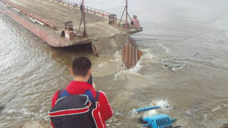 Truck Loading Barge Fail