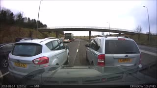 Stubborn Driver Holds Up Traffic - Video