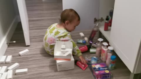 Baby is exploring Mommy's stuff
