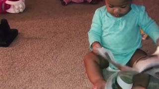 1 year old cutie determined to read!  - Video