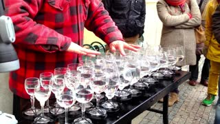 Street artist playing Hallelujah with crystal glasses