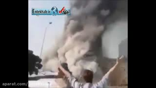 Man trying to escape from blaze while Plasco building in Tehran is collapsing - Video