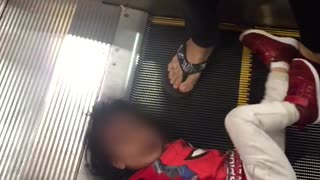 Little Girl Trapped in Escalator - Video