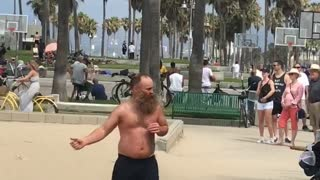 Guy shirtless beach dancing boxing with door  - Video