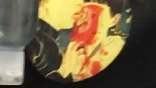 Backpack button with man licking eye