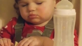 Baby nearly falls asleep while eating meal