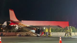Cessna Parked on Busy Highway After Emergency Landing