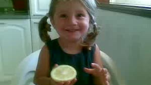 Toddler tries a lemon for the first time - Video