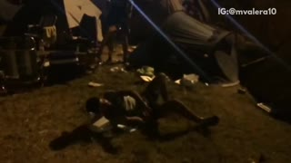 Fireworks in background guy shotguns beer and then breaks box