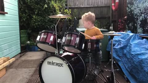 Adorable one-year-old loves playing the drums