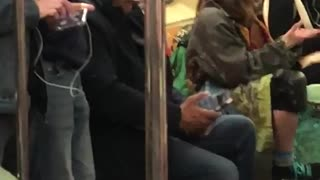 Girl with skateboard dancing with hands subway sitting down - Video