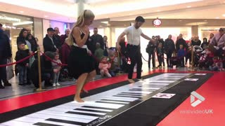 Couple Perform A Beethoven Classic On Giant Floor Piano  - Video