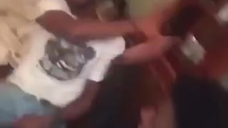 Friend slapped at wooden table