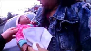 Police Officers Save Choking Baby Amidst A Busy Intersection