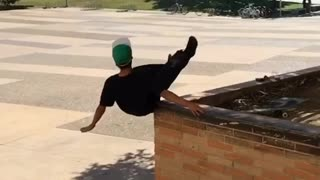 Collab copyright protection - green hat skateboard falls big ledge - Video