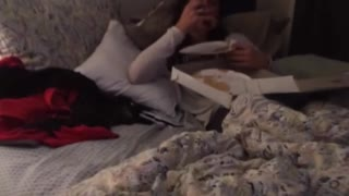 Drunk girl eating pizza in bed - Video