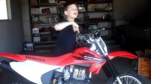 Kid Gets Dirt Bike For His Birthday And Can't Stop Jumping For Joy