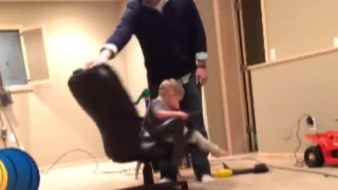 Funny Dad spins son in chair until he falls off from dizziness