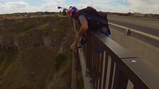 Jaw Dropping Throw and Go Base Jumping Stunt
