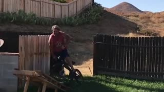 Collab copyright protection - red shirt dad bike ramp faceplant - Video