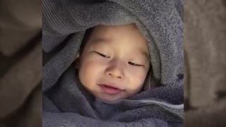 Adorable baby cracks himself up after passing gas - Video