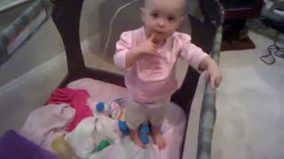 One-year-old talks her way out of a nap - Video