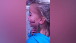 Girl Wears A Lizard As Earrings