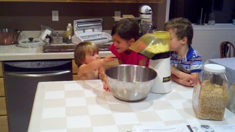 Excited toddler goes nuts for popcorn machine