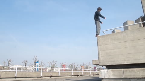 Free Runner Back Flips off High Ledge