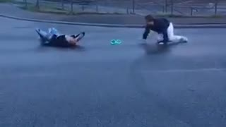 White pants friend knocks out guy from behind - Video