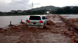 Crossing a Flooded River in a Toyota - Video