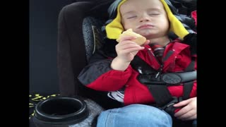 Kid falls asleep while eating ice cream