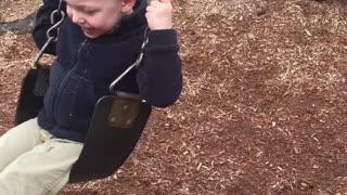 Toddler and German Shepherd have fun playing together - Video