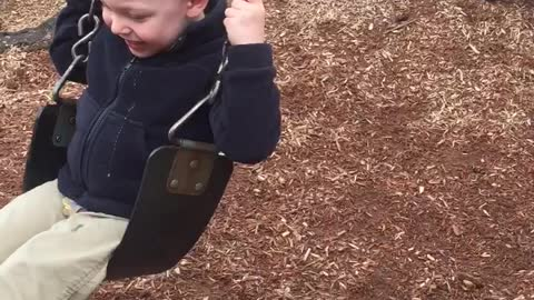 Toddler and German Shepherd have fun playing together