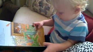 Little boy pretending to read