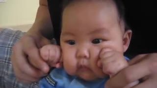 Cute Baby Works On His Right Hook With A Little Help From His Uncle - Video