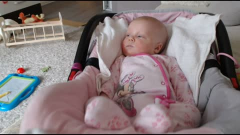 ADORABLE INFANT Can't Keep Her Eyes Open While Being Rocked !!!